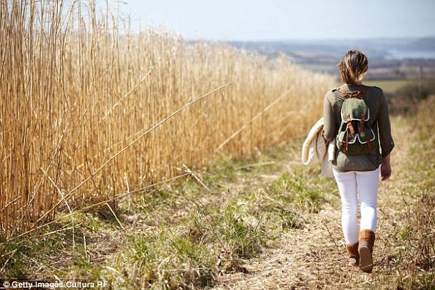 1412289227669_wps_5_Young_woman_walking_down_.jpg