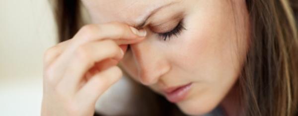 Woman having big headache